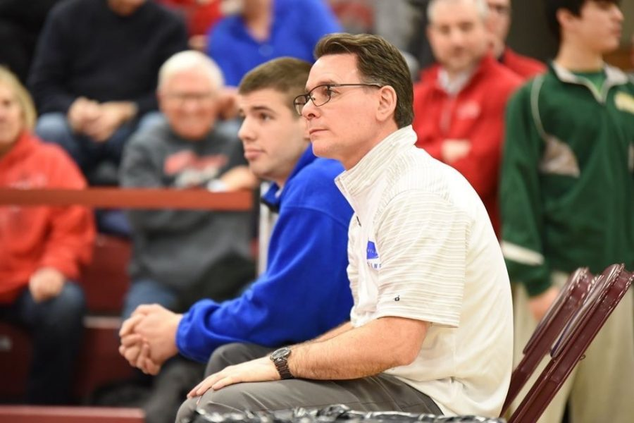 Coach Tim Andrekovich and assistant Jeremy Wilson look on at the District 6 2A championships in Altoona.