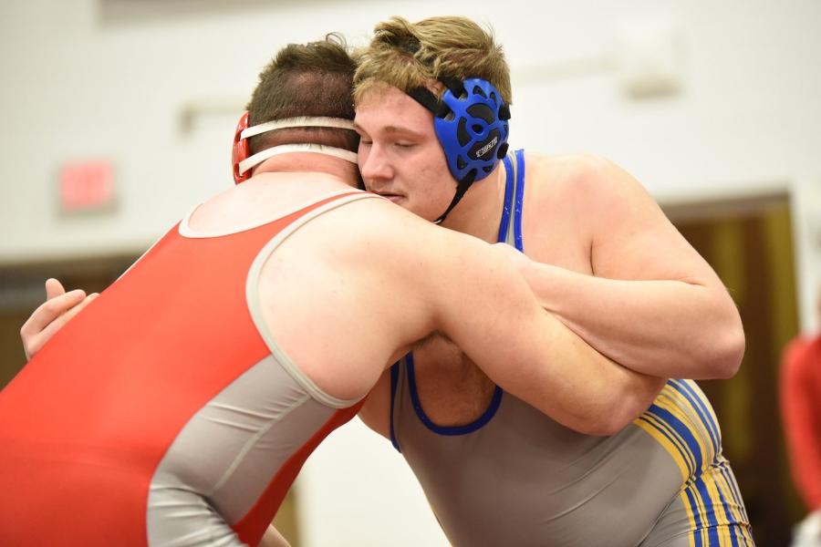 Evan Pellegrine locks up in the 285-pound  District 6 2A semifinals.