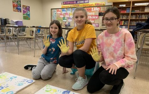 7th grade students (L to R) Emily Zacker, Gianna Juart and Kaitlynn Brallier making their mark on the middle school.
