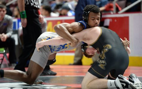 Wrestlers split matches on first day of states