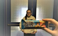 7th grader Briley Campbell enjoys eating strawberry NutriGrain bars as an after school snack.