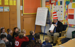 State Representative Jim Gregory on Dr. Seuss day reading to Myers Students.