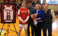 Nathan Davis, shown with brother Noah, mother Shelly and father Todd, recently wrapped up an outstanding basketball career at Seton Hill.