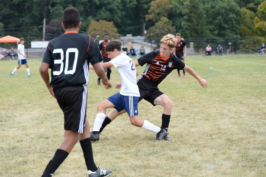 Brendan Andrews fights for the ball against Juniata.