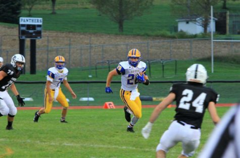 Zach Mallon bursts through a gigantic hole for some of his 151 yards on the ground against Noethern Befford.