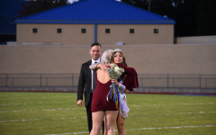 Malia Danish gets a hug from Jamyson Focht as she is crowned 2020 Homecoming queen.