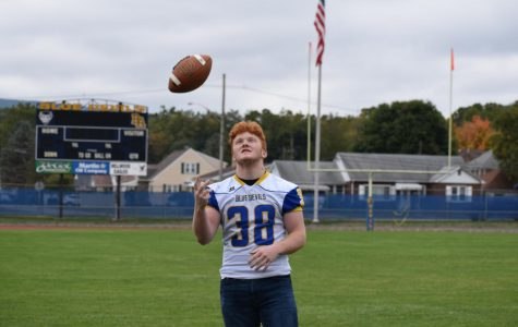 Nick Plank is leading the undefeated Blue Devil football team with strong performances on both offense and defense.