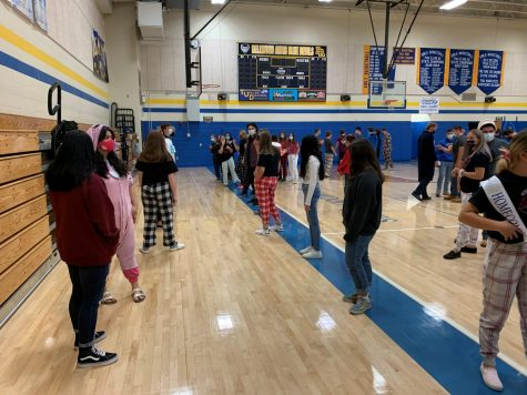 Ms. Hull and the chorus spent fourth period Friday in the gym with Mr. Lovrich and the football team, preparing to sing the National Anthem tonight at Homecoming.