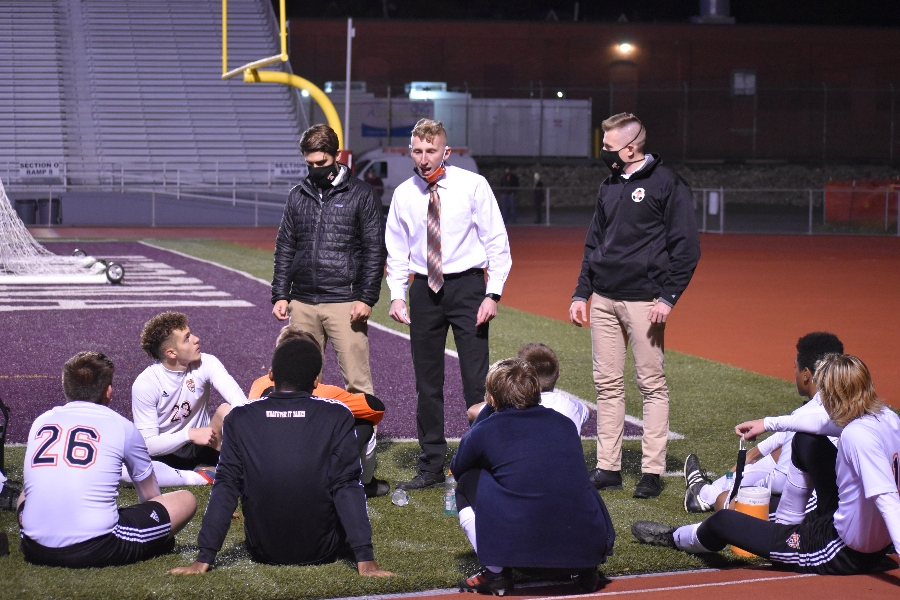 Soccer+coach+Alex+Bartlett+talks+strategy+with+his+team+at+halftime+of+the+district+6+3A+championship.