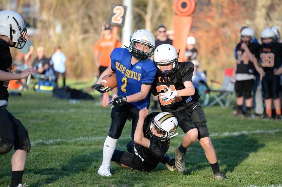 Chase Plummer fights for extra yardage in the first quarter against Tyrone.
