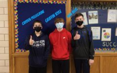 8th Graders Cayden Pellegrine and Griffin Kyle and Max Belis getting excited for their game against Claysburg.