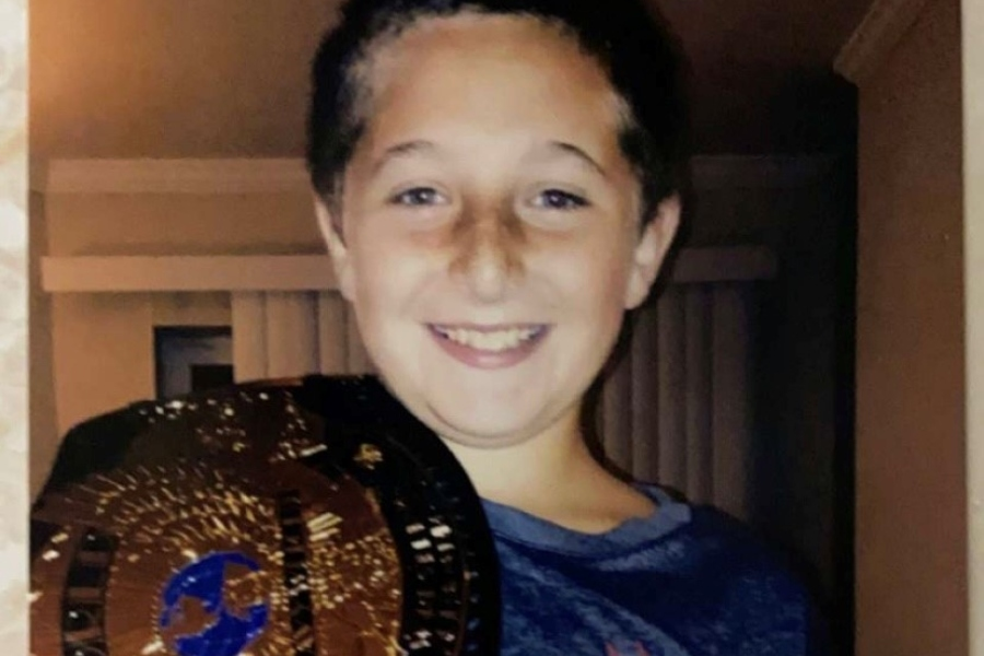 Trenton Pellegrino, seen here in his elementary days with a WWE championship, has been a serious World Wrestling Entertainment fan for most of his life.