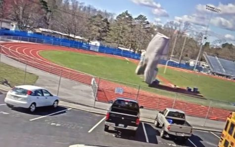 Video cameras caught the pole vault pit as it took flight in 50 mile per hour winds, headed straight for cars in the parking lot.