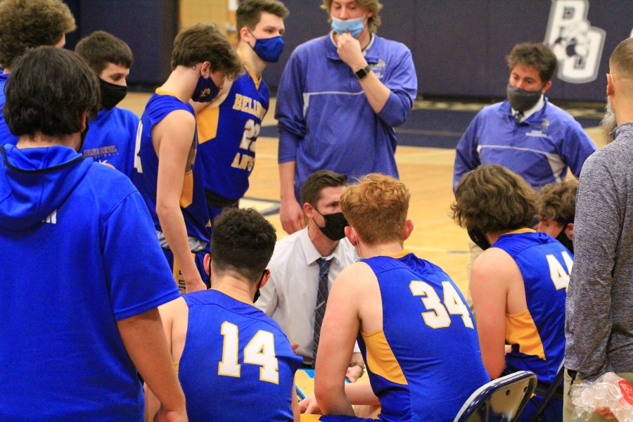 Coach Cassidy talks to his players during a timeout in the District 6 3A playoffs against PO.