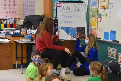 Cami Focht and Chloe Hammond read to second graders as part of Read Across America Week.