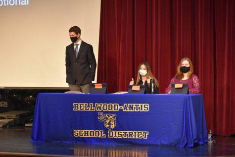 Zach Mallon, Malia Danish, and Rebecca Burns prepare for to get started at the annual CHS schoolwide debates.