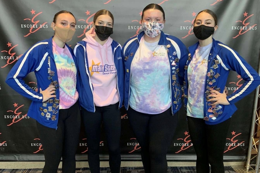 Dancers Lauren Heisler, Emily Martin, Sasha Neyman, and Kali Lonsinger take some time for a photo during a break at their most recent competition.