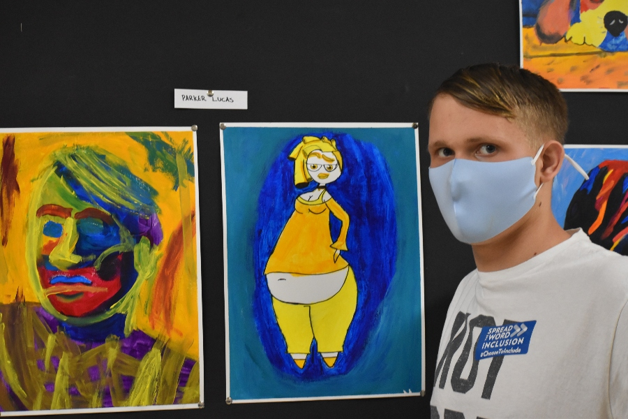 Parker Lucas poses with his artwork.