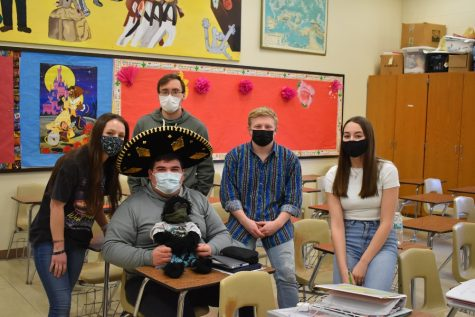 Spanish 3 students Caroline Nagle, Ethan Carper, Nic Caraccilo (holding monkey), Hunter Gregg, and Kali Lonsinger pose with Senor Aguafiesta.