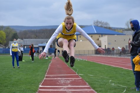Brielle Campbell takes to the air in the long jump against Tyrone.