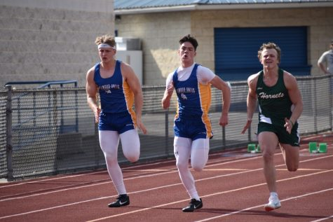 Sean Mallon and Cooper Keen break out in the 100 meter dash.