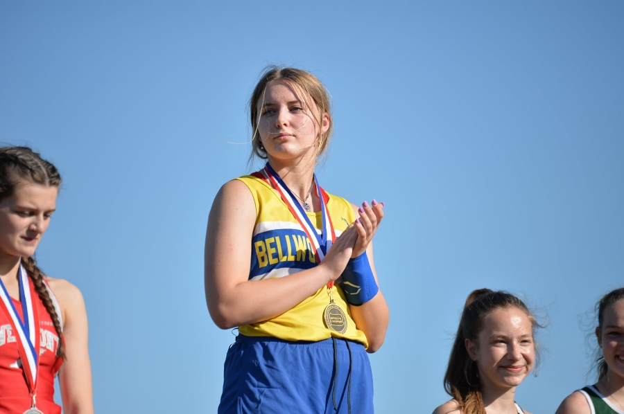 Lydia Worthing stands atop the podium as the gold medal winner in the pole vault at the District 6 2A championships.
