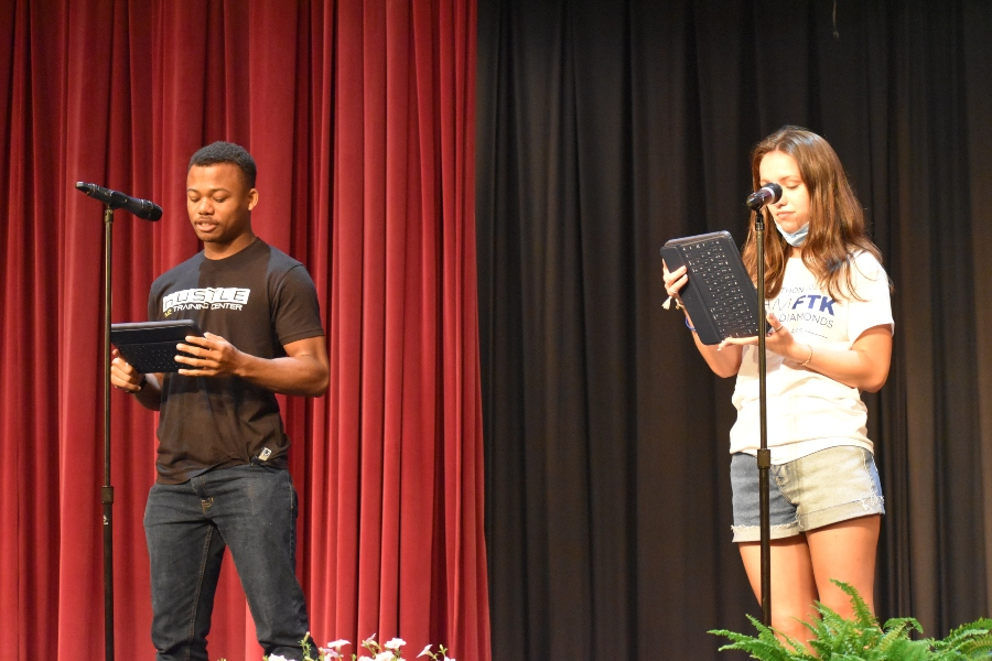 Caroline Nagle and Alex Taylor deliver their poem about concussions at the poetry slam.