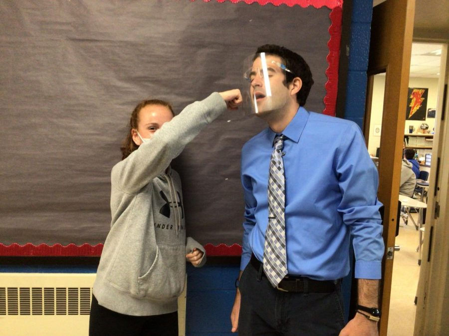 Marissa Cacciotti and Mr. Hunter battle it out in a game of Are You Smarter Than a 7th Grader.