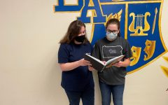 Senior editors Lauren Young and Gabriella Finn check out the yearbook. B-A's yearbook was recognized for its excellence by Jostens, which awarded the book a silver medal.