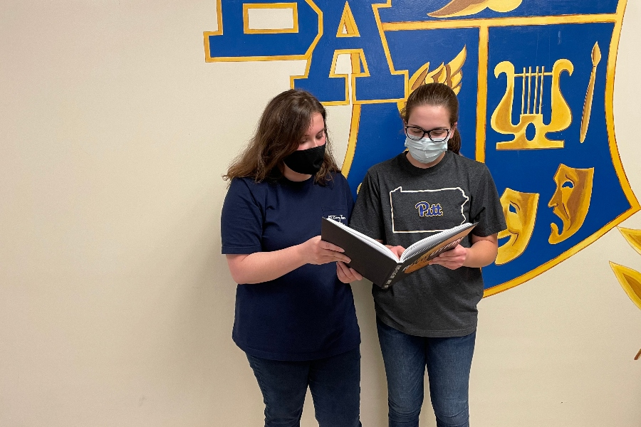 Senior editors Lauren Young and Gabriella Finn check out the yearbook. B-A