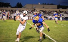 Brandon Cherry (83) goes in for a tackle last Friday against Northern Bedford.