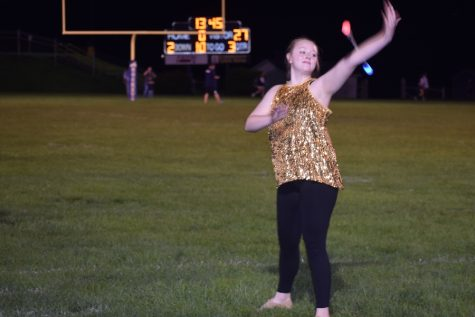 Jayce Miller is a standout as a singer and as a majorette.