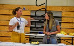 Mrs. Stinson and Mrs. Auberzinsky talk at the Renaissance table at the recent activity fair.