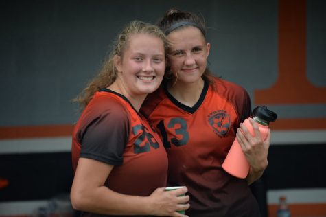 Jaylee Shuke (left) poses with classmate Sophia Nelson. Shuke registered a shutout in net yesterday for the girls soccer team, which defeated Bellefonte.