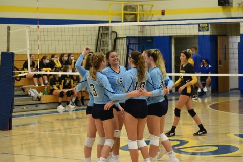 B-A Volleyball team celebrates after scoring point