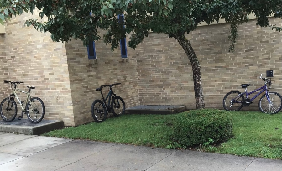 Highschool students are forced to park their bikes against the school wall.
