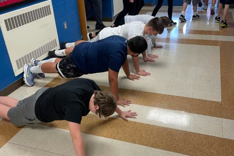 Middle school boys bang out their 22 pushups as part of the 22 Pushup Challenge to support veterans struggling with thoughts of self-harm.