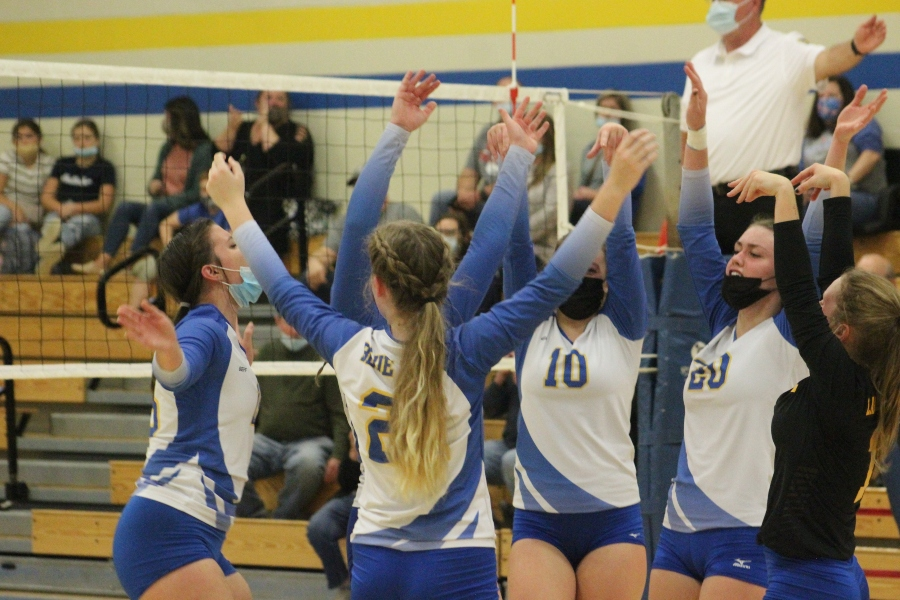 The B-A volleyball team celebrates following a point against West Branch.