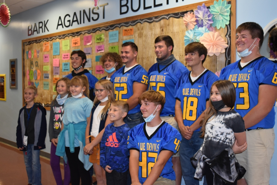 Members of the B-A football team read with students at Myers and the middle school last Friday.