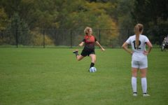 Jaylee Shuke kicks one out of trouble in Tuesdays co-op soccer game against Clearfield.
