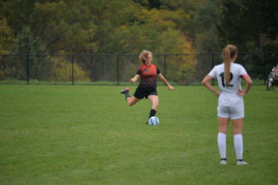 Jaylee+Shuke+kicks+one+out+of+trouble+in+Tuesdays+co-op+soccer+game+against+Clearfield.