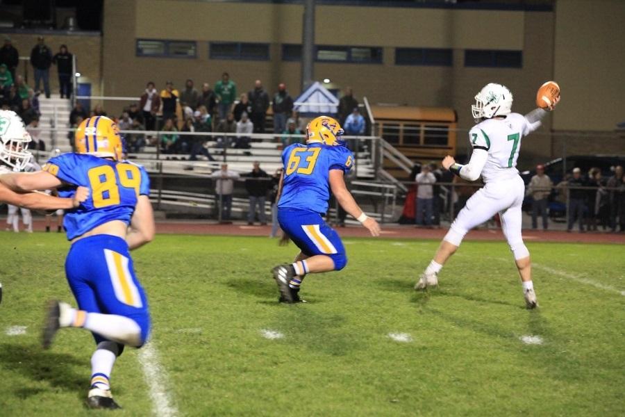 Junior Andrew Nycum pursues JV quarterback Lambert Palmer.
