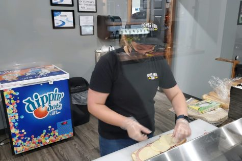 Sarah Berkowitz is enjoying her job at Powerhouse Subs in Tyrone.